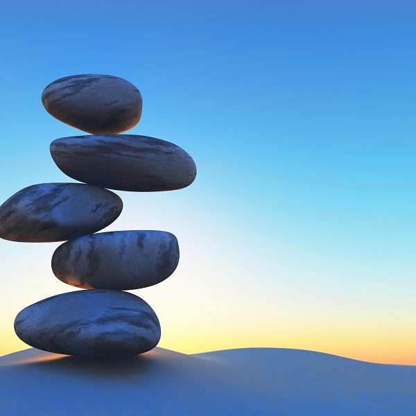 3D render of balancing pebbles on sand against a sunset sky